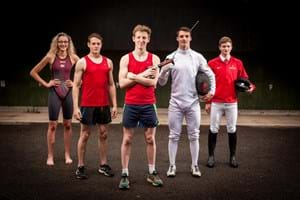5 students standing together with each student wearing kit for one of the five sports in modern pentathlon