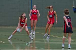 Girl about to pass the ball during a netball game