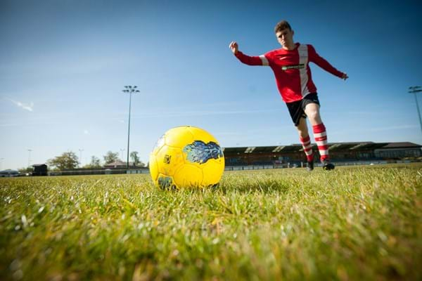 Hartpury student kicking a football
