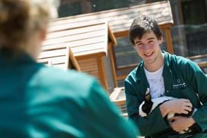 Student holding a rabbit in Hartpury's animal collection