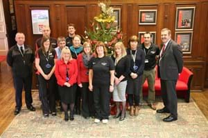 A group of Hartpury staff standing in Hartpury house