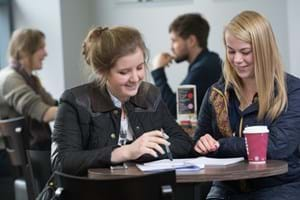 two students in red and blacks - Hartpury's onsite cafe