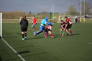 Students playing hockey at Hartpury