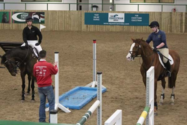 Image for Equine students jumping for joy after event hosting success