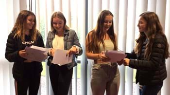 Hartpury students celebrating successful A-level results to win places at university