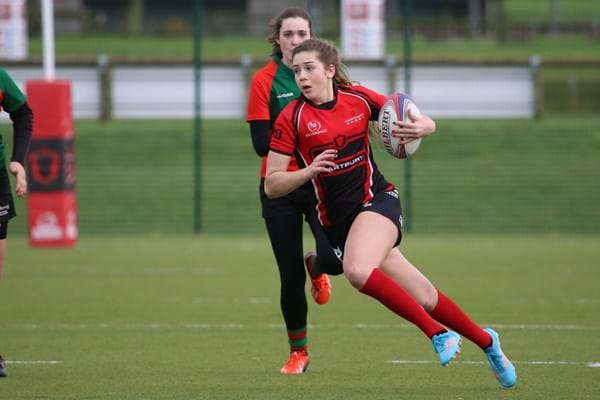 Hartpury student running with the ball during a rugby game