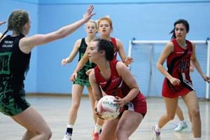 hartpury student holding the ball during a netball game