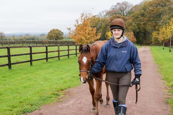 Holly Bowsher leading a foal